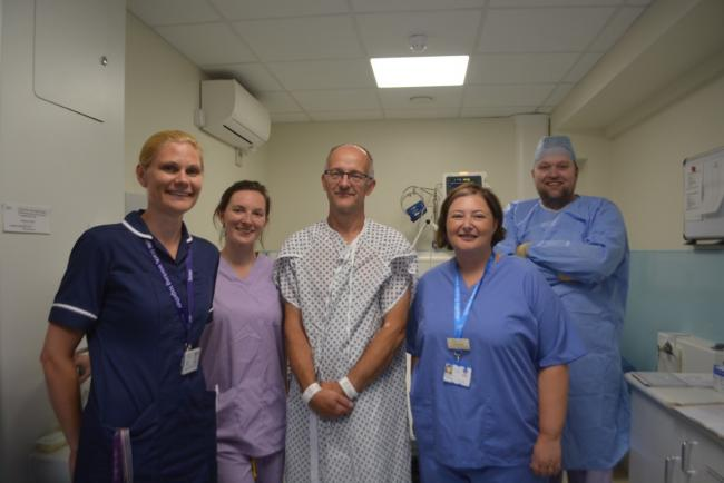 Feeling better - patient John Freed with staff following his procedure at Southend Hospital