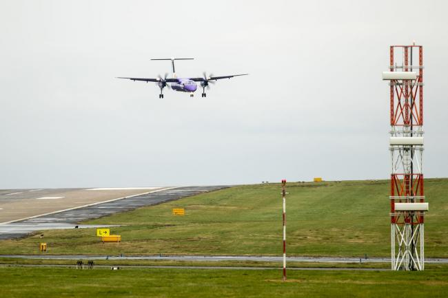 A plane comes in to land at Leeds Bradford Airport