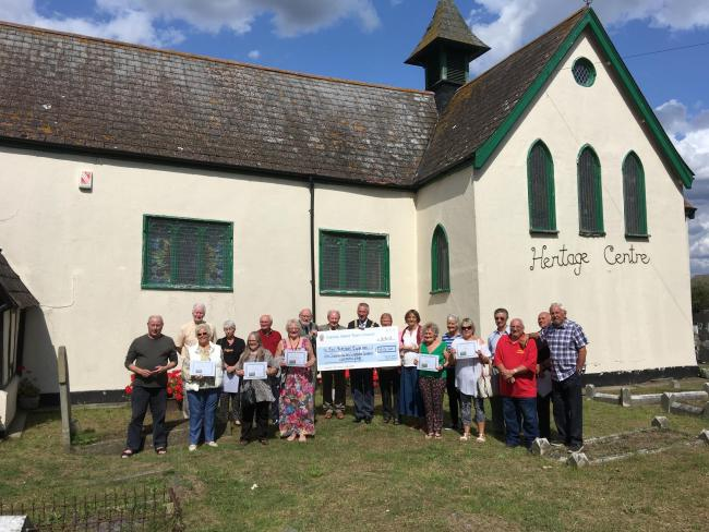 Donation - representatives from the council and heritage centre and residents who took part