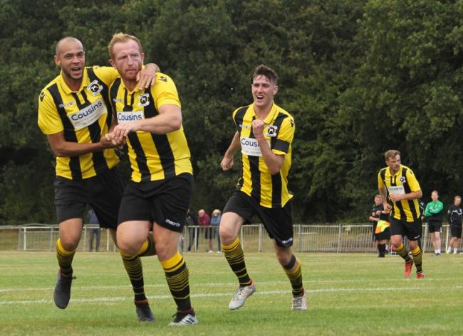 Celebrate - Adam Vyse (second from left) netted in Basildon United's win over Coggeshall Town Picture: MATTHEW THOWNEY