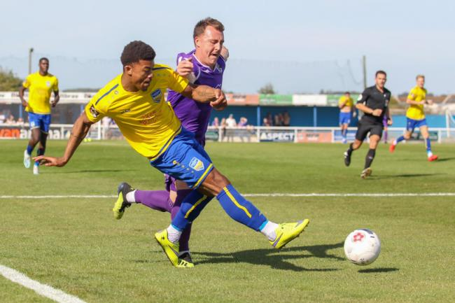 On the charge - Decarrey Sheriff looks to break away from Dartford goalscorer Alex Flisher Picture: PAUL RAFFETY