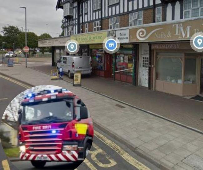 Firefighters rush to battle fire at shoe business in shops parade