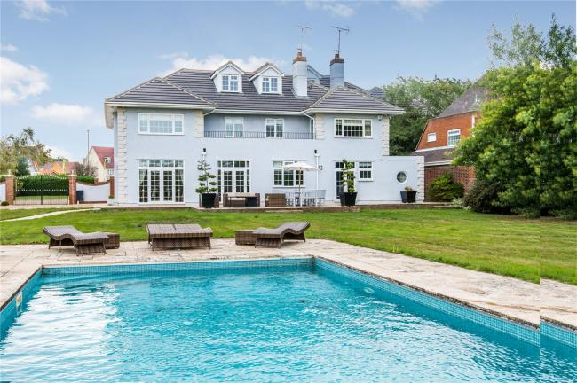 Luxurious - the property boasts a swimming pool and is valued at £2.35million