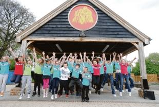 Pupils jump for joy at the opening of their new eco-centre