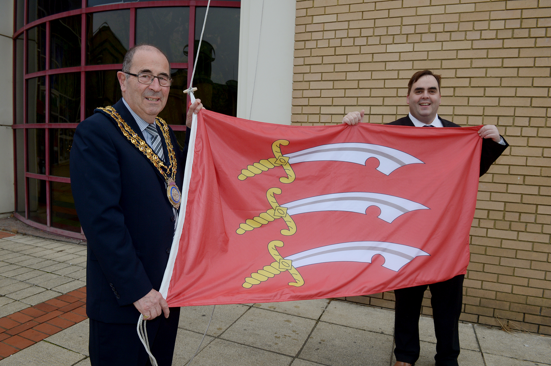 Basildon Centre, St Martin's Square, Basildon.Mayor of Basildon cllr David Harrison and cllr Kerry Smith from Basildon Council raises the county's flag to show its support for Essex Day.. ..