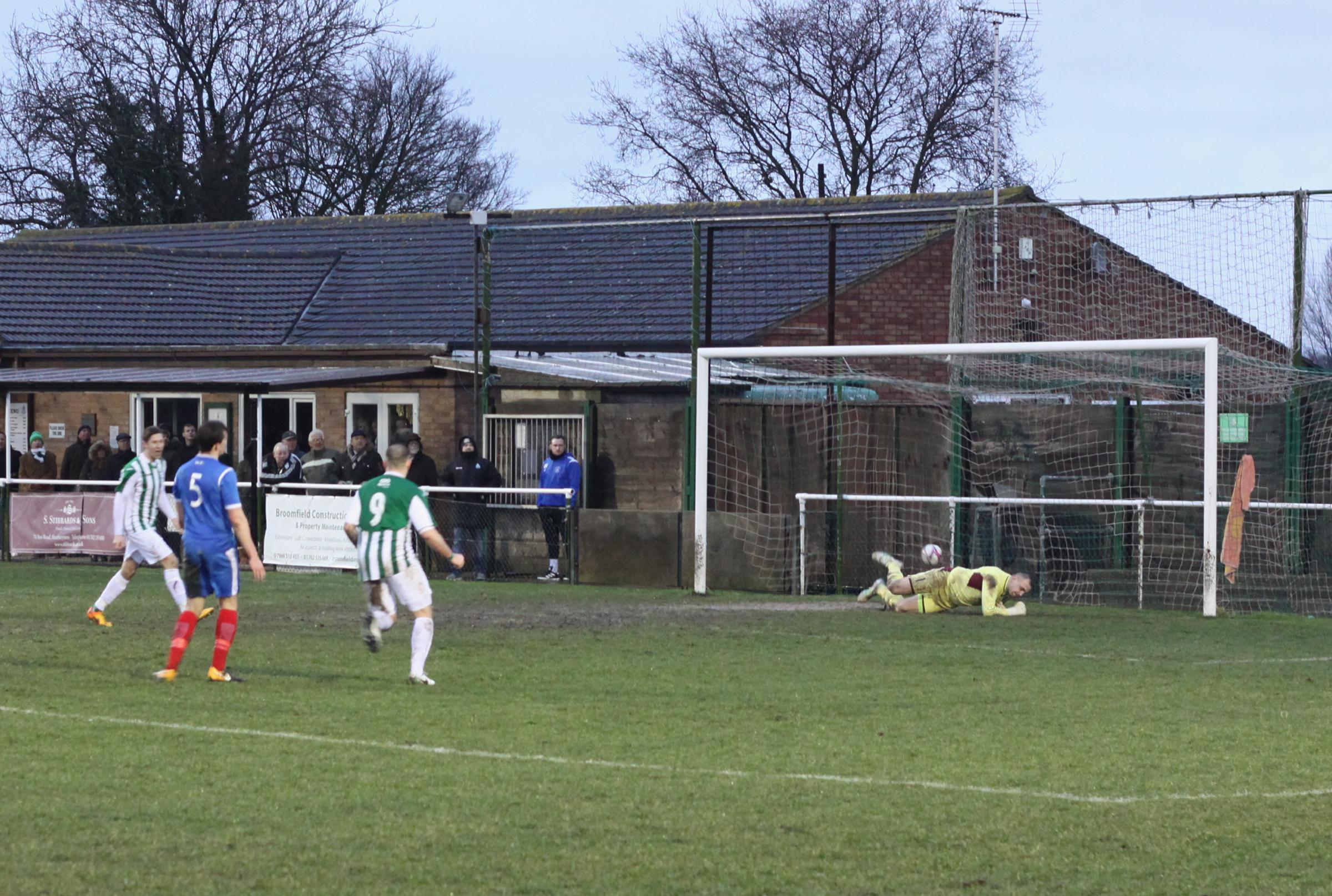 Euphoria - Neil Richmond scores the winner from the penalty spot Picture: MARK CLEVELAND