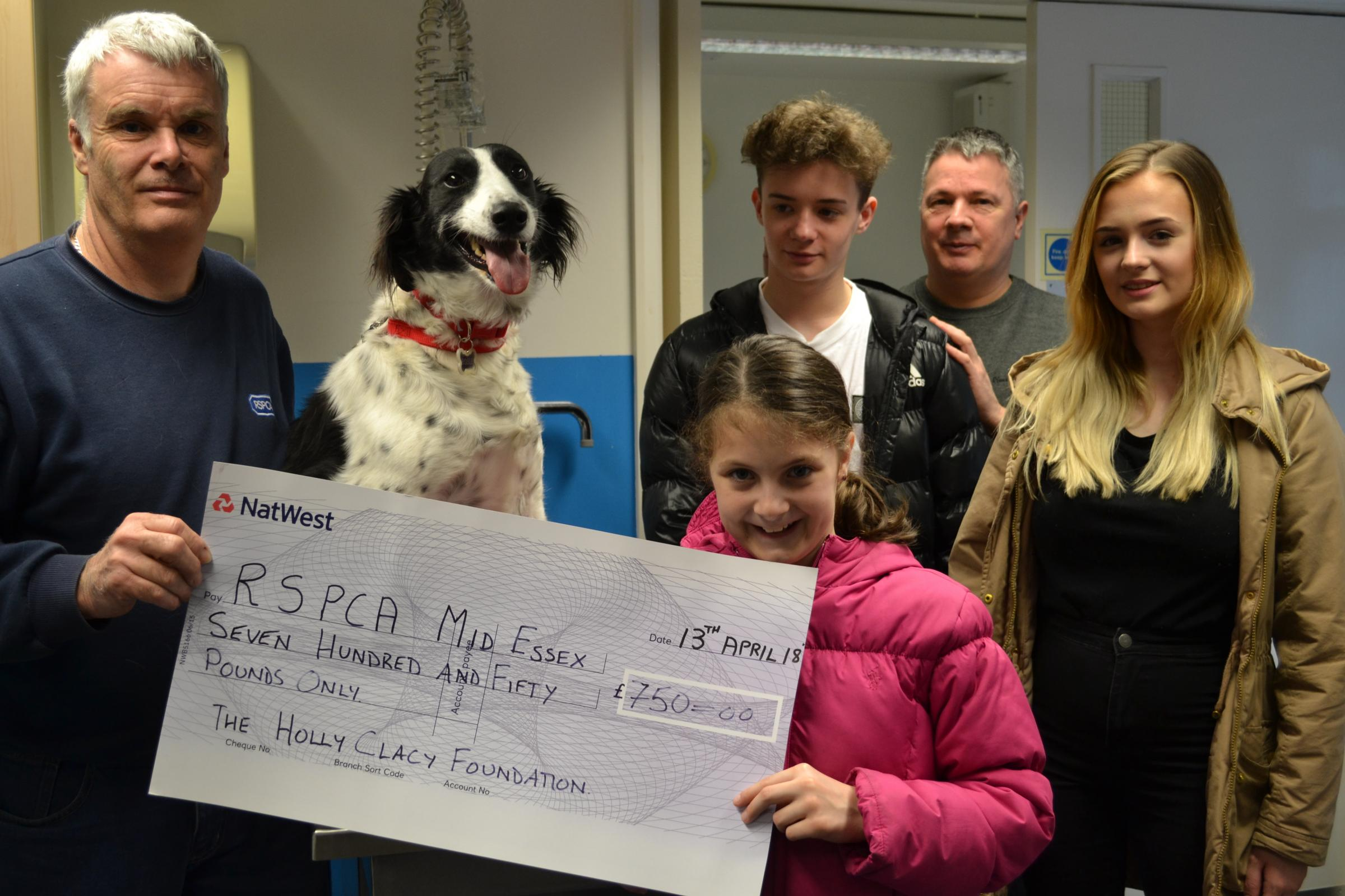 DONATION: David, Etholle, Elliott, and Lilia Clacy presenting a cheque for £750 to Mid Essex RSPCA Chairman Clive Vallis