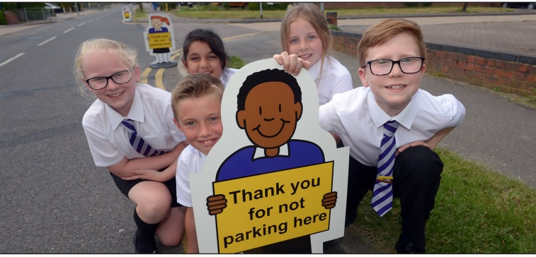 N Scheme - some of the students from the school in Rayleigh with one of the bollards outside the school
