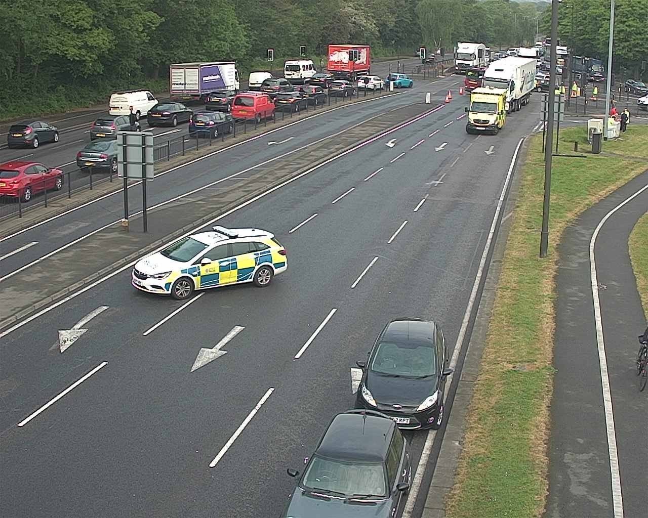 Police close road after crash at busy junction on A127