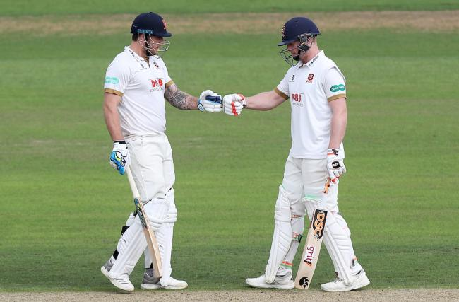 Team work - Matt Coles (left) touches gloves with Simon Harmer during Essex's game with Nottinghamshire Picture: GAVIN ELLIS/TGS PHOTO