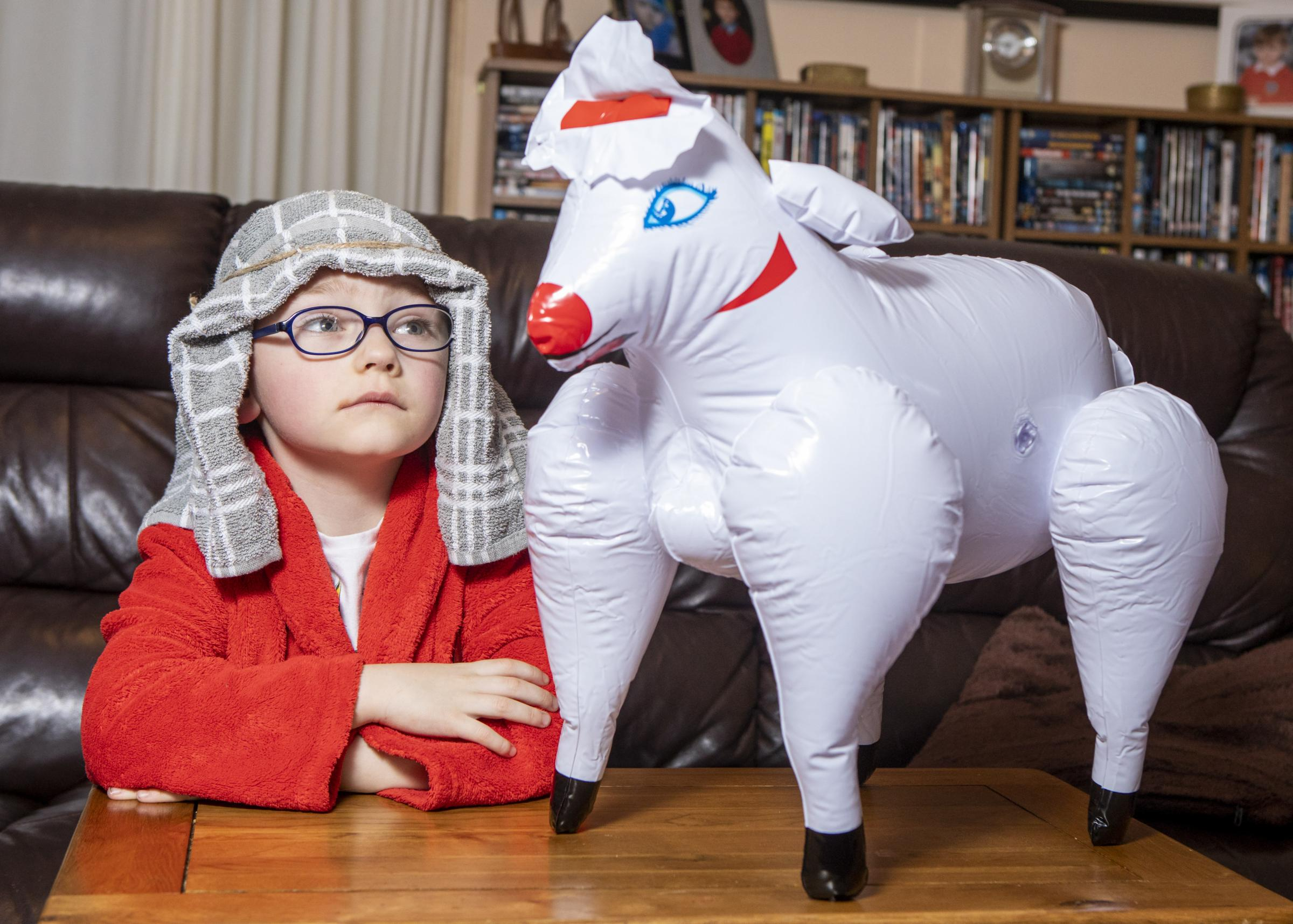 Helen Cox's son Alfie and the inflatable sheep she bought (SWNS)