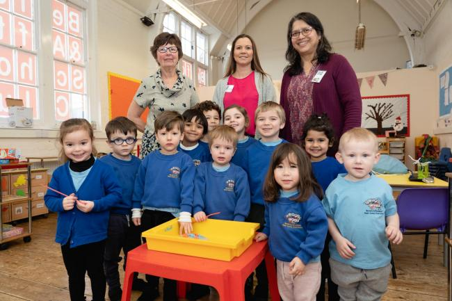 Delighted - Julie Ash, Angela Tathan and Fiona D'Silva and some of the children at the preschool in Billericay