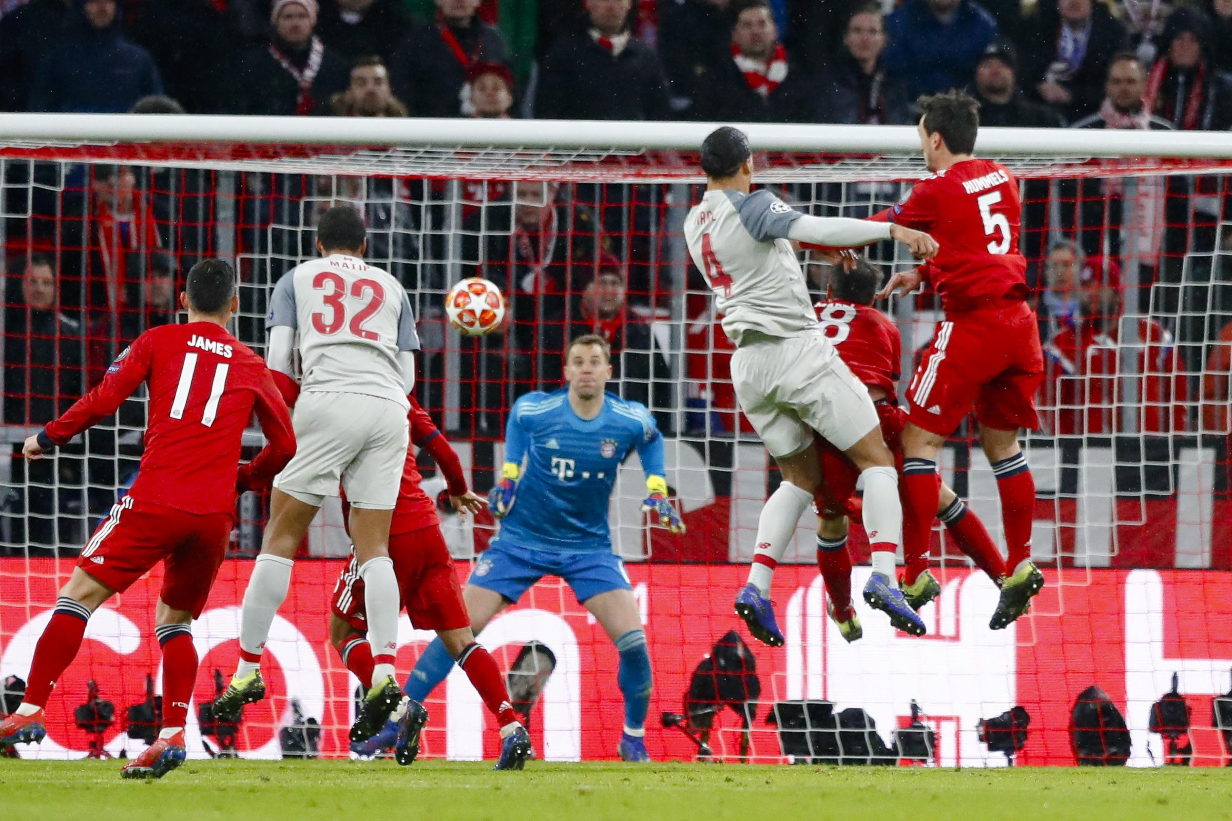 Virgil Van Dijk, centre right, scores for Liverpool against Bayern Munich