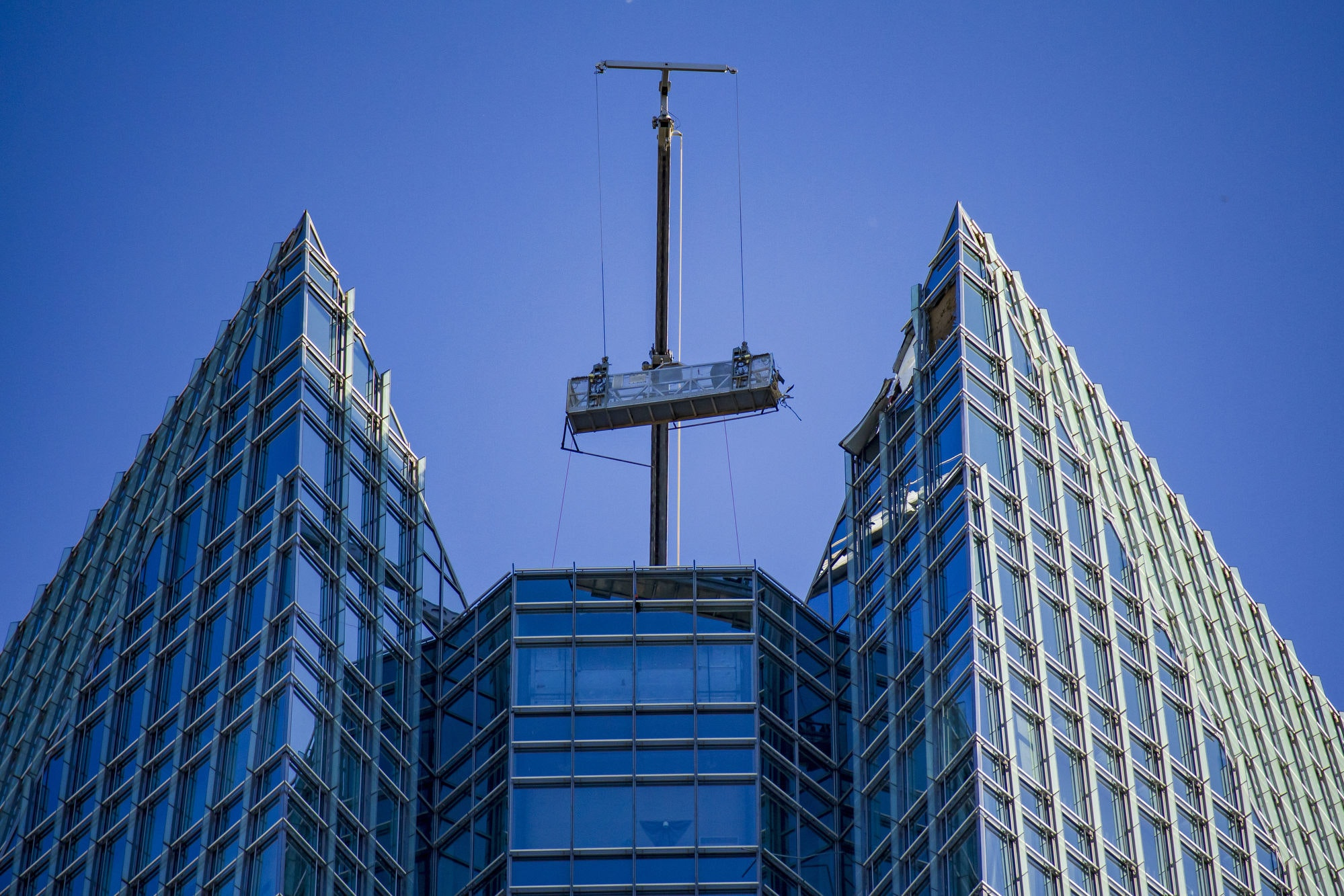 Crews work to rescue workers off of a broken lift on top of the Devon Tower in downtown Oklahoma City