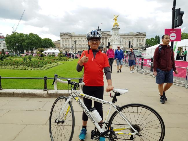 Finish line - Aayush Danej, 11, in front of Buckingham Palace after cycling there from Basildon
