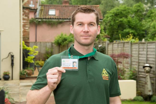 An OFTEC technician with his ID card